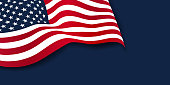 Waving American flag of the United States of America isolated on navy blue background. 4th of july. Memorial Day. Independence day. Labor day. Veterans day.