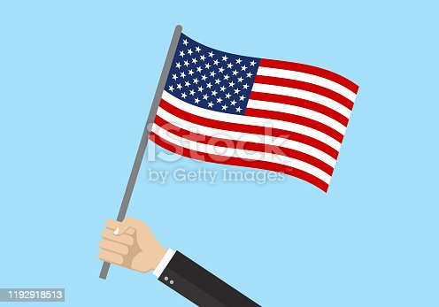 istock USA waving flag. Hand holding American flag. National symbol of the United States of America. Vector illustration. 1192918513