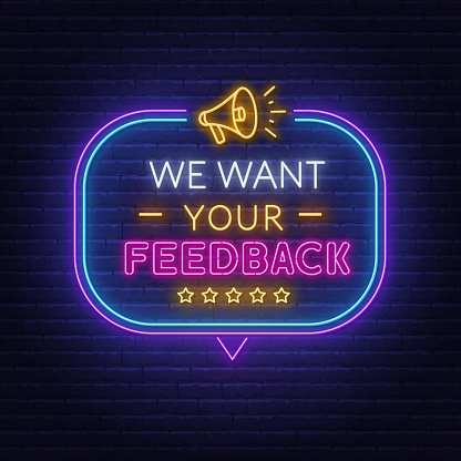 We want your feedback neon sign in speech bubble frame with megaphone.