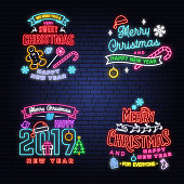 We wish you a very sweet Christmas and Happy New Year neon sign with snowflakes, christmas candy, cookie. Vector. Neon design for xmas, new year emblem, bright signboard, light banner. Night signboard