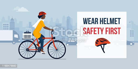 Wear helmet when riding a bike, woman cycling in the city street wearing a helmet, safety concept