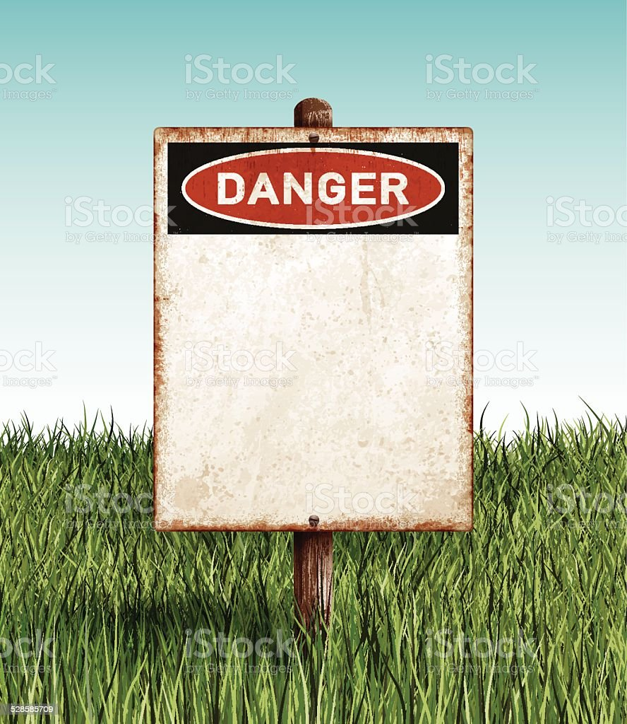Weathered blank danger placard with wooden post and grass field vector art illustration