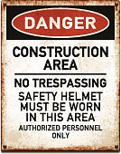 Vintage metal danger sign with construction area wear safety helmet warning. Grunge square placard with rusty stains, four screws and red and black banner reading DANGER. Photorealistic vector illustration isolated on white. Layered EPS10 file with transparencies and global colors. Individual elements and textures. Related images linked below.