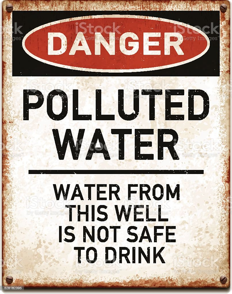 Weathered metallic placard with danger polluted water text_vector vector art illustration