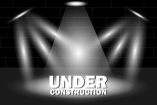 Web page poster Under construction with 3d text in spotlight on scene