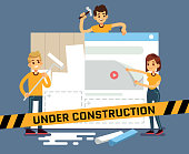 Website under construction vector cartoon concept with web designers