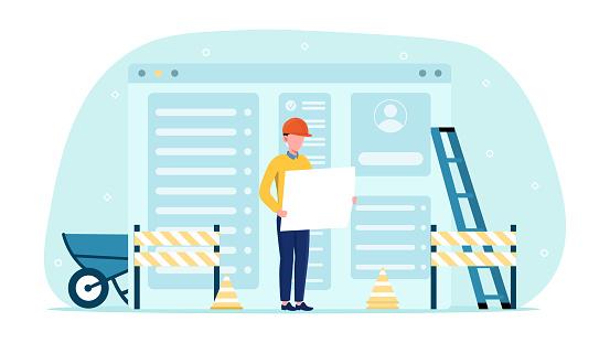 Website under construction with caucasian developer