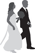 Vector silhouettes of a bride and groom walking together.