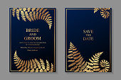 Set of two cards with golden frames and fern on a dark blue background.