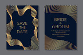 Set of two cards with golden geometric waves of lines on a dark blue background.