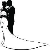 A bride and groom silhouette wedding couple, in a bridal dress gown