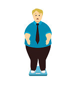 Weight loss. Overweight man on scales