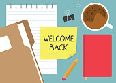 istock welcome back written on yellow sticky note 1322712216