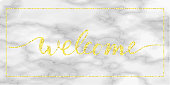 welcome gold text on marble