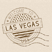Welcome to Las Vegas, USA. Tourist brown stamp with US national flag on beige background