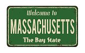 Welcome to Massachusetts vintage rusty metal sign on a white background, vector illustration