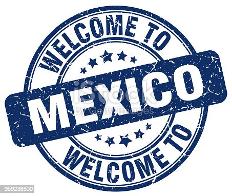 istock welcome to Mexico blue round vintage stamp 959238800