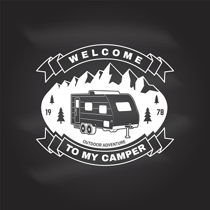 Welcome to my camper. Live, love, camp. Vector on the chalkboard Concept for shirt or , print, stamp or tee. Vintage typography design with camper trailer and mountain silhouette. Camping quote.