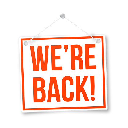 We're Back! welcome back re-opening business return sign.