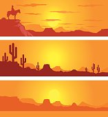 Set of 3 western desert scenes at sunset or sunrise with orange sky and a cowboy and cactus in the foreground. Art is on easily edited layers.