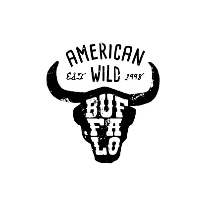 Western Logo Skull Buffalo head Draw Grunge style. Wild West symbol sing of a cow's Horns and Retro Typography.