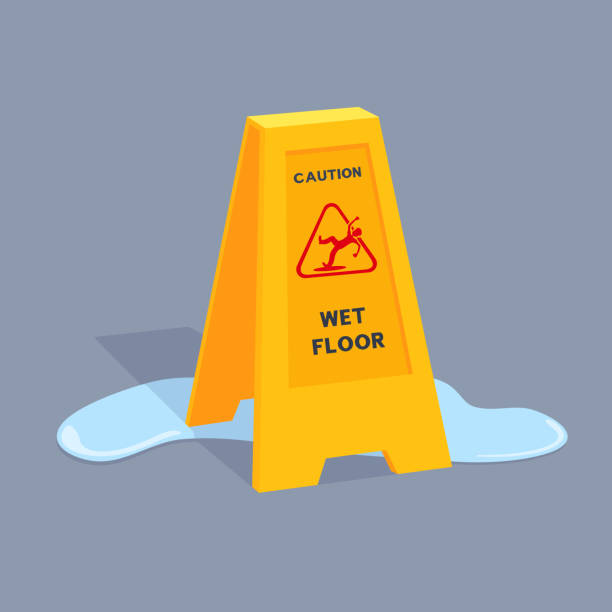 Wet floor caution sign stands on a puddle, casts shadow. Alert triangle with falling man, caution inscription. Yellow color plastic banner. Slippery surface warning. wet stock illustrations
