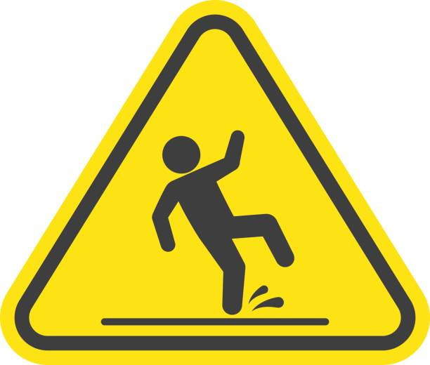 Wet floor warning sign. Wet floor warning vector sign isolated on white background. Yellow triangle with falling man in modern flat style. EPS 10. slippery stock illustrations