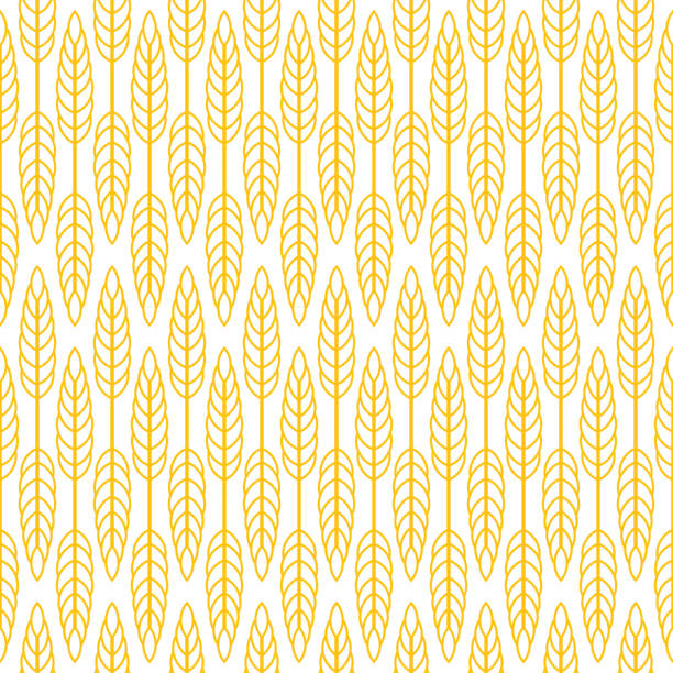 Wheat seamless pattern Wheat seamless pattern. Yellow print on white background bread backgrounds stock illustrations