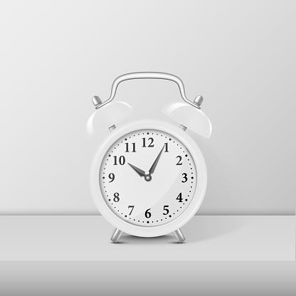 White alarm clock closeup standing on white table. Design template, mockup. Stock vector illustration, eps10