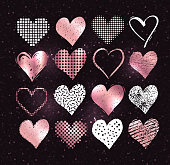 Vector collections of white and rose gold grunge Valentine hearts on dark glitter background.