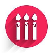 White Birthday cake candles icon isolated with long shadow. Red circle button. Vector Illustration