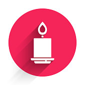 White Burning candle icon isolated with long shadow. Cylindrical aromatic candle stick with burning flame. Happy Halloween party. Red circle button. Vector.