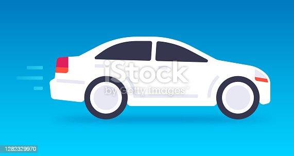 istock White Car Driving 1282329970