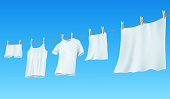White clean linen and clothes hanging on a rope. Vector illustration