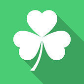 White clovers leaf icon on green background vector illustration