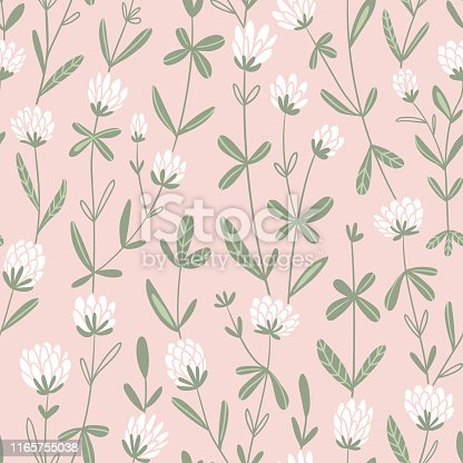 White clover flowers.  Vector floral seamless pattern. Cute hand-drawn  pattern design for fabric, wallpaper or wrap paper.