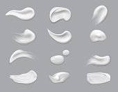 istock White cosmetic brush strokes isolated, makeup 1199402633