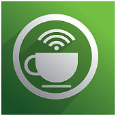 White cup of coffee and WiFi symbol on green background
