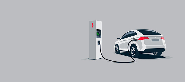 White Electric Car Suv Charging at the Charger Station