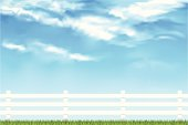 Vector illustration of a crisp white fence with a summer cloud sky in the background.  High res image included in download. Clouds are 100% mesh.