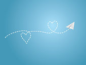 A white folded paper plane making love sign route on blue background to show happy travel emotion vector illustration