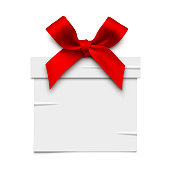 Vector illustration of a white gift box sticker with red bow. Place for text.
