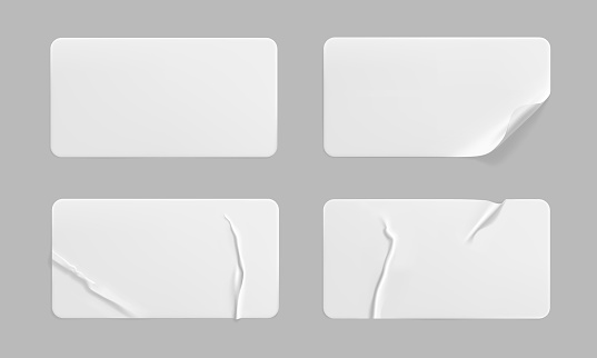 White glued crumpled stickers with curled corners mock up set. Blank white adhesive paper or plastic sticker label with wrinkled and creased effect. Template label tags close up. 3d realistic vector.