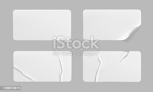 istock White glued crumpled stickers with curled corners mock up set. Blank white adhesive paper or plastic sticker label with wrinkled and creased effect. Template label tags close up. 3d realistic vector 1288610615