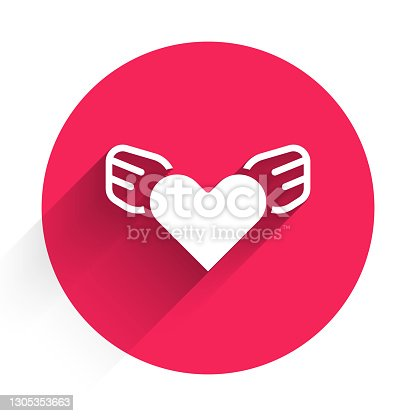 istock White Heart with wings icon isolated with long shadow. Love symbol. Valentines day. Red circle button. Vector 1305353663