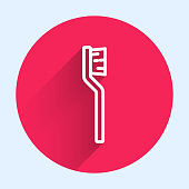 White line Toothbrush icon isolated with long shadow. Red circle button. Vector.