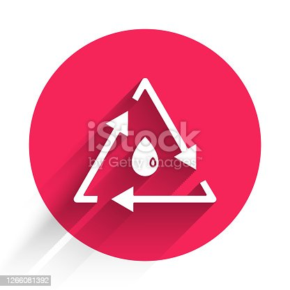 istock White Oil drop with recycle icon isolated with long shadow. Red circle button. Vector Illustration 1266081392