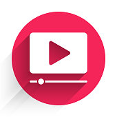 istock White Online play video icon isolated with long shadow. Film strip with play sign. Red circle button. Vector Illustration 1266094665