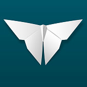 White origami butterfly on dark background vector