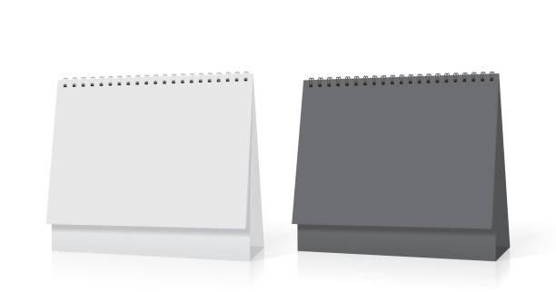 illustrations, cliparts, dessins animés et icônes de un calendrier livre blanc se dresse sur la table. maquette modèle vector - ellen page